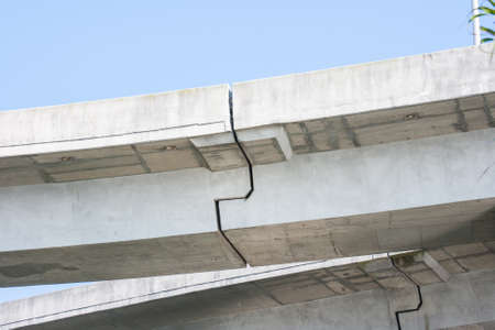 Concrete overpass cracks where constucted together Stock Photo