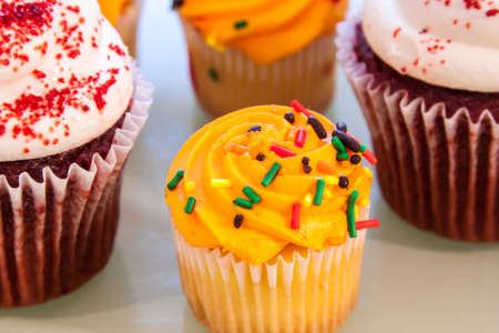 Cupcakes in different sizes, flavors and colors Stock Photo - 15448063