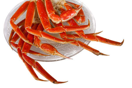 Crablegs cooked and placed on a fancy clear plate on a white background Banque d'images