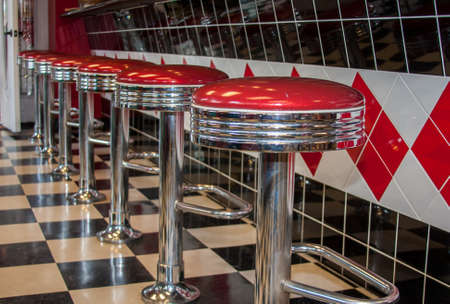 stools: Classic 50s style bar stools in chrome and red Stock Photo