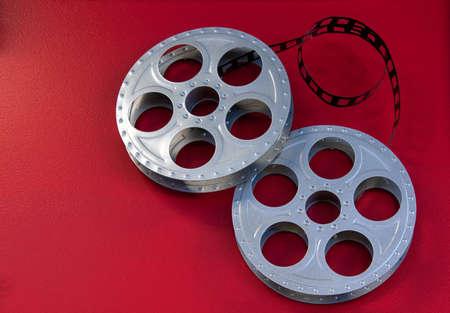 Metal movie film reels on a red background