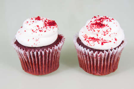 Red Velvet cupcake with white cream cheese frosting and sprinkled with red sugar photo