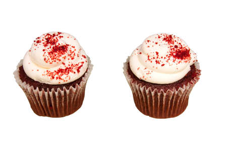 Red Velvet cupcakes with white cream cheese frosting and sprinkled with red sugar