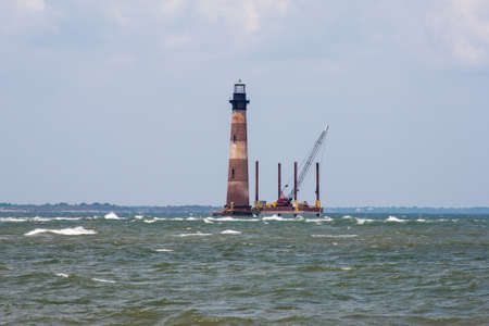 renovated: Old lighthouse in the ocean being renovated Stock Photo