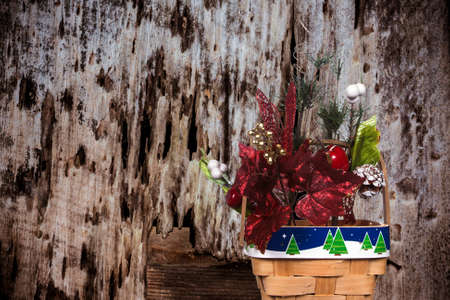 decayed: Christmas Basket On A Decayed Wood Background