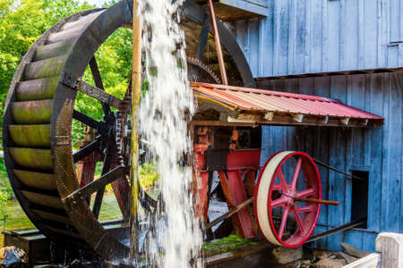Antique Water wheel on the side of a mill photo