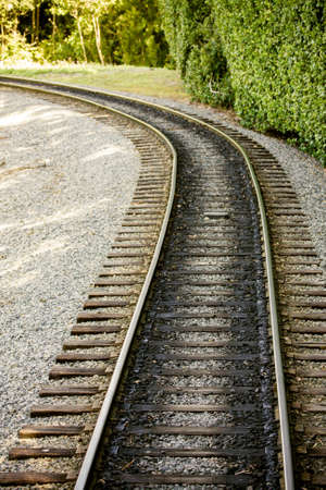 Train track winding around the bend Stock Photo