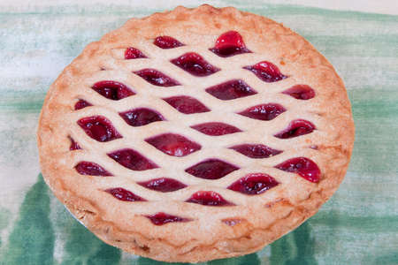 Homemade cherry pie with lattice pattern on top Stock Photo