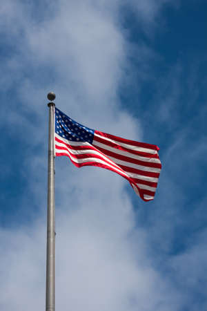 American flag waving on a cloudy sky