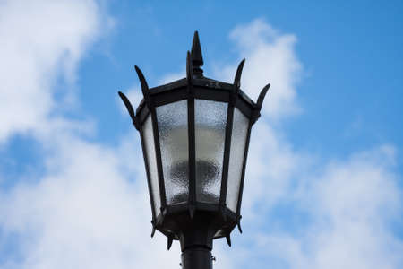 Streetlight against a cloudy sky