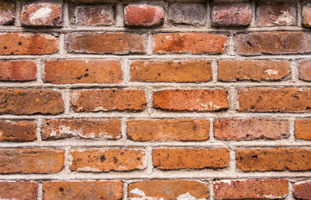 Aged decorative brick wall Stock Photo