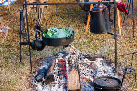Cooking dinner over an open flame