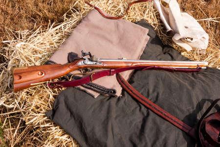 Civil War rifle laying on a bedroll