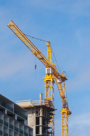 Yellow crane working on a construction site