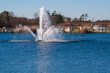 Water fountain spraying water in a marina 版權商用圖片