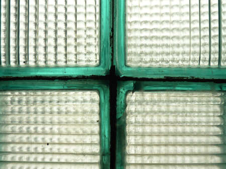 Old green glass bricks making a cross photo