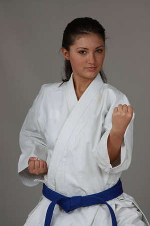 Beautiful young teen in karate suit