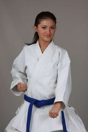 karate female: Beautiful young teen in karate suit