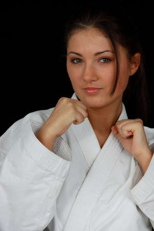 Beautiful young teen in karate suit photo
