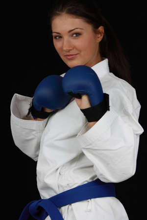 defense: Beautiful young teen in karate suit