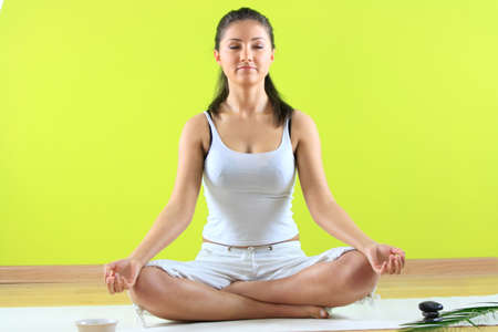 Young yoga female doing yogatic exericise on flor Stock Photo - 4680679