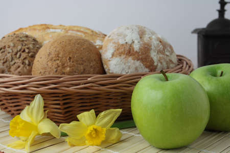 Variety of whole wheat bread in basket and greena apples Stock Photo - 4685187