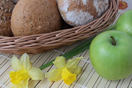 Variety of whole wheat bread in basket and greena apples Stock Photo - 4685166