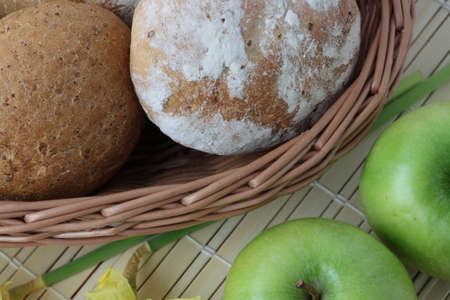 Variety of whole wheat bread in basket and greena apples Stock Photo - 4685180
