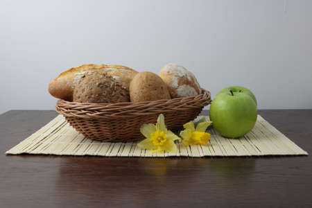 Variety of whole wheat bread in basket and greena apples Stock Photo - 4685183
