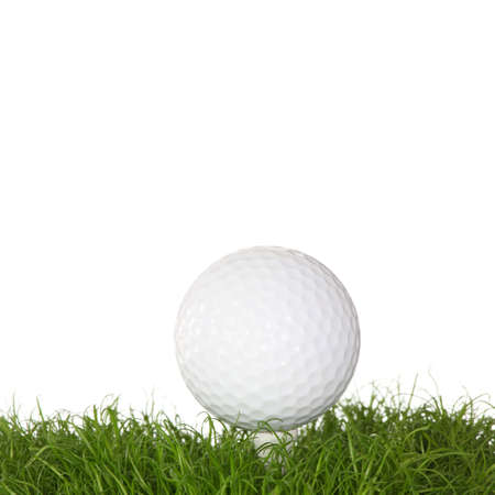 A golf ball in the grass isolated on white background photo