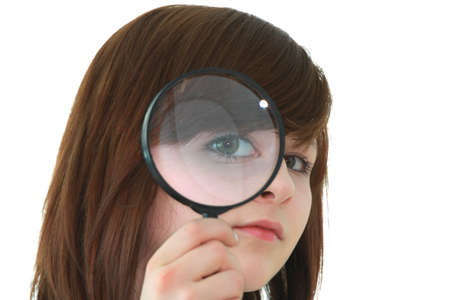 Young student with magnifier isolated on white background photo