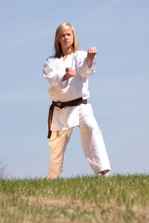 Karate blond girl training outdoor photo