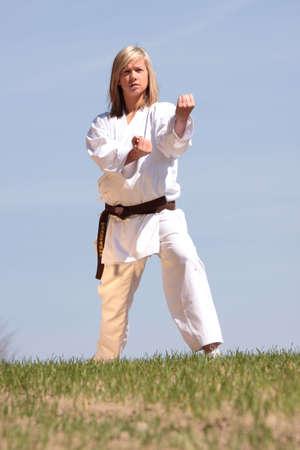 Karate blond girl training outdoor photo