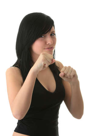 girl punch: Young atractive girl with scary mine trying to make boxing