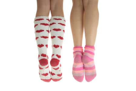 Four legs with colorful socks (isolated on white) Stock Photo - 4831889