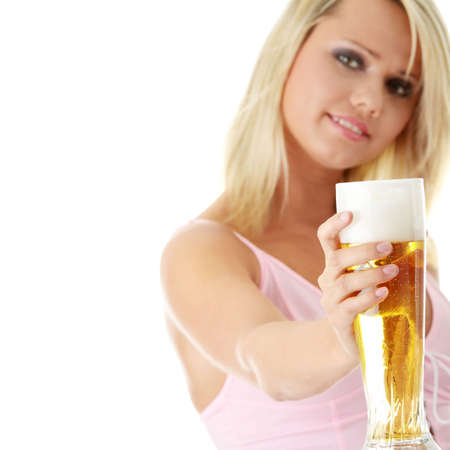 pilsner glass: Young atractive blonde in sexy lingerie holding a beer - focus on beer