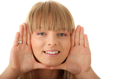Young woman frame her face with hands photo