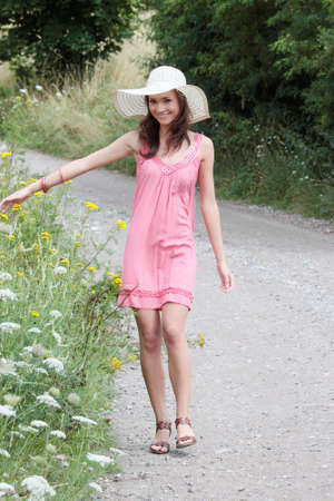a beautiful girl in big summer hat in the country Stock Photo - 5361661
