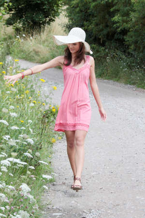 a beautiful girl in big summer hat in the country Stock Photo - 5361946