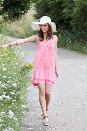 a beautiful girl in big summer hat in the country Stock Photo - 5361671