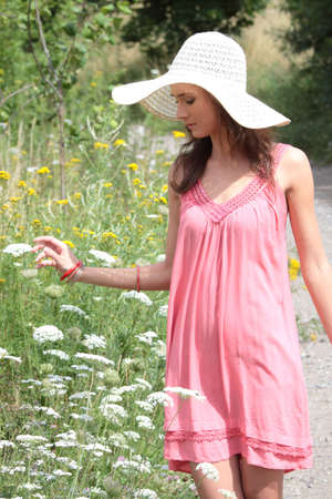 a beautiful girl in big summer hat in the country Stock Photo - 5361948