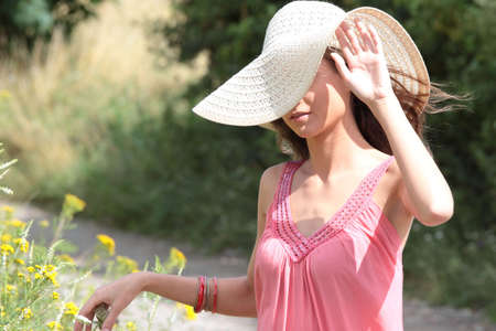 a beautiful girl in big summer hat in the country Stock Photo - 5361666