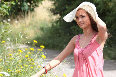 a beautiful girl in big summer hat in the country Stock Photo - 5361585