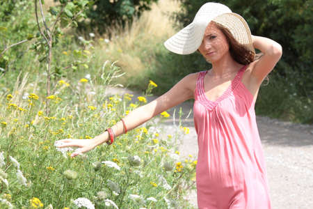 a beautiful girl in big summer hat in the country Stock Photo - 5361575