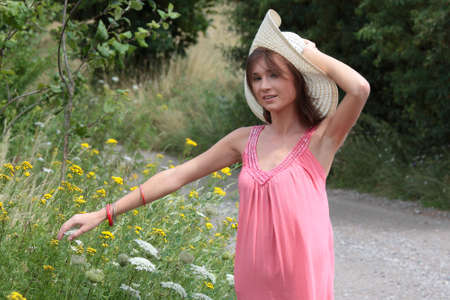 a beautiful girl in big summer hat in the country Stock Photo - 5361949