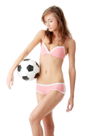 Fashion young woman with a football ball isolated over a white background Stock Photo - 5361374