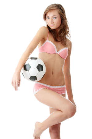 Fashion young woman with a football ball isolated over a white background photo