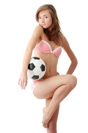 Fashion young woman with a football ball isolated over a white background Stock Photo - 5361349