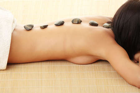 parte: Attractive woman getting spa treatment isolated on white