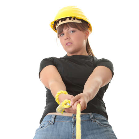 Young woman builder holding yellow rope photo